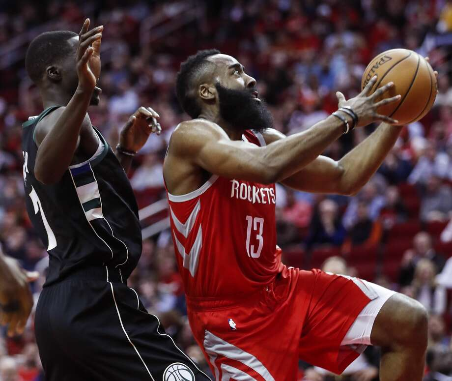 Houston Rockets guard James Harden (13) drives to the basket past Milwaukee Bucks forward Thon Maker (7) during the first half of an NBA basketball game at Toyota Center on Wednesday, Jan. 9, 2019, in Houston. Photo: Brett Coomer/Staff Photographer