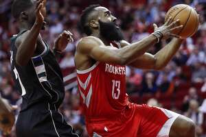 Houston Rockets guard James Harden (13) drives to the basket past Milwaukee Bucks forward Thon Maker (7) during the first half of an NBA basketball game at Toyota Center on Wednesday, Jan. 9, 2019, in Houston.