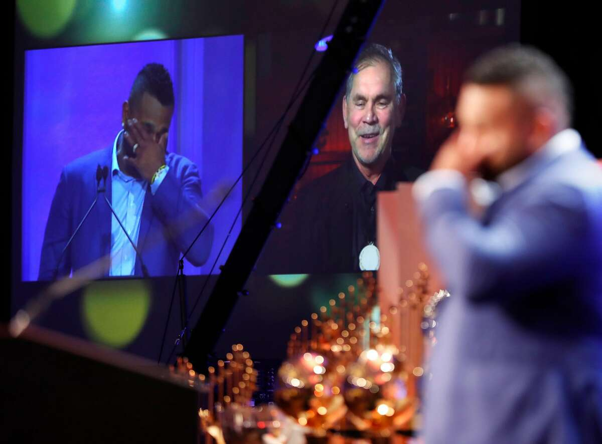 Pablo Sandoval laughs as Bruce Bochy speaks on video board during Coaching Corps Game Changer Awards at Fairmont in San Francisco, Calif. on Wednesday, January 9, 2019.