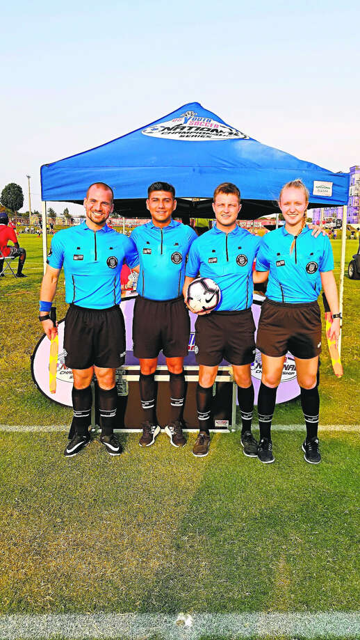 Joey Knoff (far left) is shown as part of the referee crew that worked the US Youth Soccer U13 boys national championship match in Frisco, Texas, last July. Photo: Photo Provided