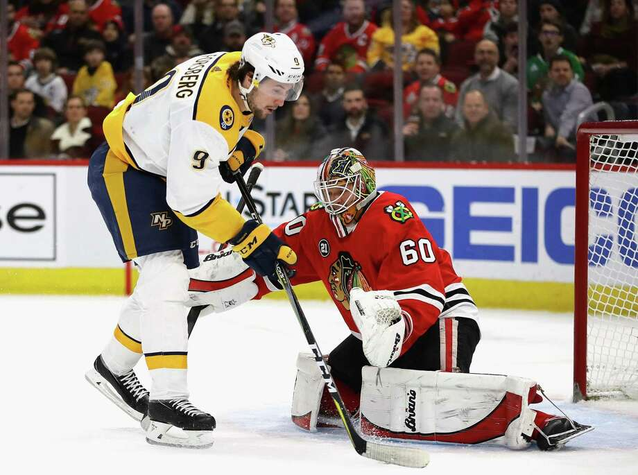 CHICAGO, ILLINOIS - JANUARY 09: Filip Forsberg #9 of the Nashville Predators tries to get off a shot against Collin Delia #60 of the Chicago Blackhawks at the United Center on January 09, 2019 in Chicago, Illinois. (Photo by Jonathan Daniel/Getty Images) Photo: Jonathan Daniel / 2019 Getty Images