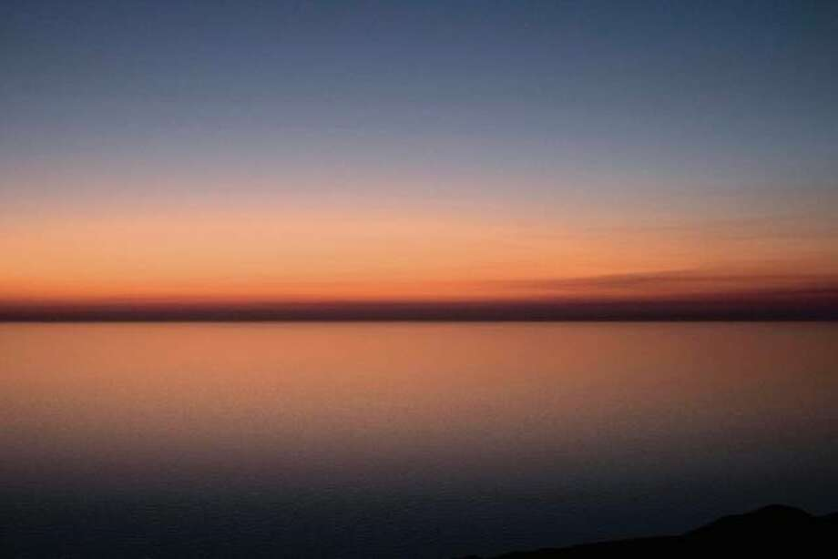 Photographer Richard Leffler of Springfield took this photograph of Lake Michigan at sunset from atop the 450-foot-tall Sleeping Bear Dunes in Michigan. Photo: Photo By Robert Leffler