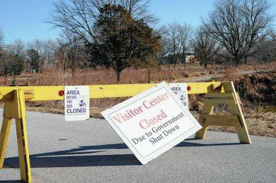 Signs announce a wildlife refuge visitor center is closed as a partial government shutdown continues. The U.S. Fish and Wildlife Service is directing dozens of wildlife refuges to return to work to make sure hunters and others have access despite the government shutdown, according to an email obtained Wednesday by The Associated Press. Photo: Nati Harnik | AP