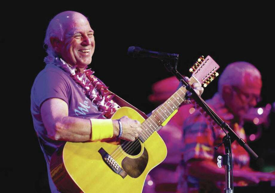 Jimmy Buffett on stage at The Cynthia Woods Mitchell Pavilion. Buffett and The Coral Reefer Band return to the Pavilion on June 1. Tickets go on sale Jan. 18 at 10 a.m.