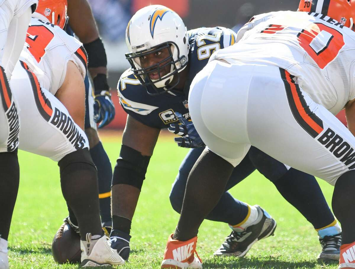 CLEVELAND, OH - OCTOBER 14, 2018: Defensive tackle Brandon Mebane #92 of the Los Angeles Chargers awaits the snap in the third quarter of a game against the Cleveland Browns on October 14, 2018 at FirstEnergy Stadium in Cleveland, Ohio. Los Angeles won 38-14. Mebane is likely to play for the Chargers this week following the death of 7-week old daughter. Makenna Mebane died on Jan. 3. She was born on Nov. 12 with a defective heart condition. The Chargers defensive end was in Omaha, Nebraska, with his wife, Amena, and other two children, 4-year-old Mahailey and 2-year-old Makai, for most of the past two months while Makenna received treatment for a stomach infection. (Photo by: 2018 Nick Cammett/Diamond Images/Getty Images)