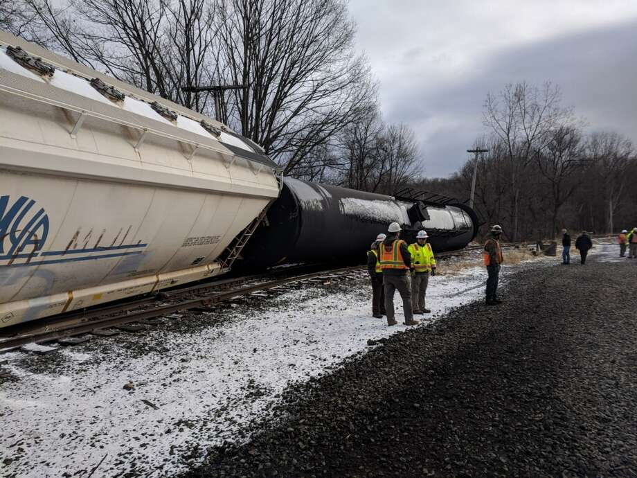 State Police and other investigators remained at the scene Thursday of a train derailment in North Hoosick. The tanker cars carrying propane were knocked off of the tracks but none of the gas leaked, officials said. Photo: Rensselaer County