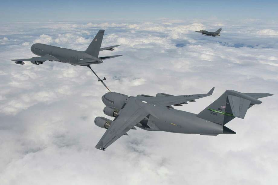 A Boeing's KC-46 tanker conducts a refueling test in July 2016 with a C-17 Globemaster III aircraft. (Photo courtesy Boeing) Photo: Paul Weatherman / Copyright 2016 Boeing Company - Photo by Paul Weatherman