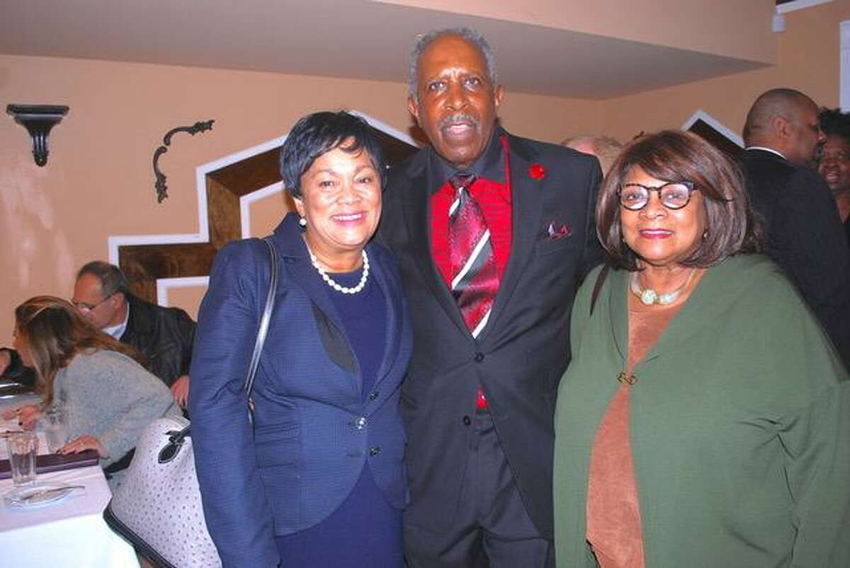 """New Haven Mayor Toni Harp and her Executive Assistant Andrea Scott congratulate retired Connecticut Supreme Court Justice Lubbie Harper Jr. at an event held at Brazi's Italian Restaurant at Long Wharf in New Haven to celebrate Harper being named the New Haven Register """"2018 Person of the Year."""""""