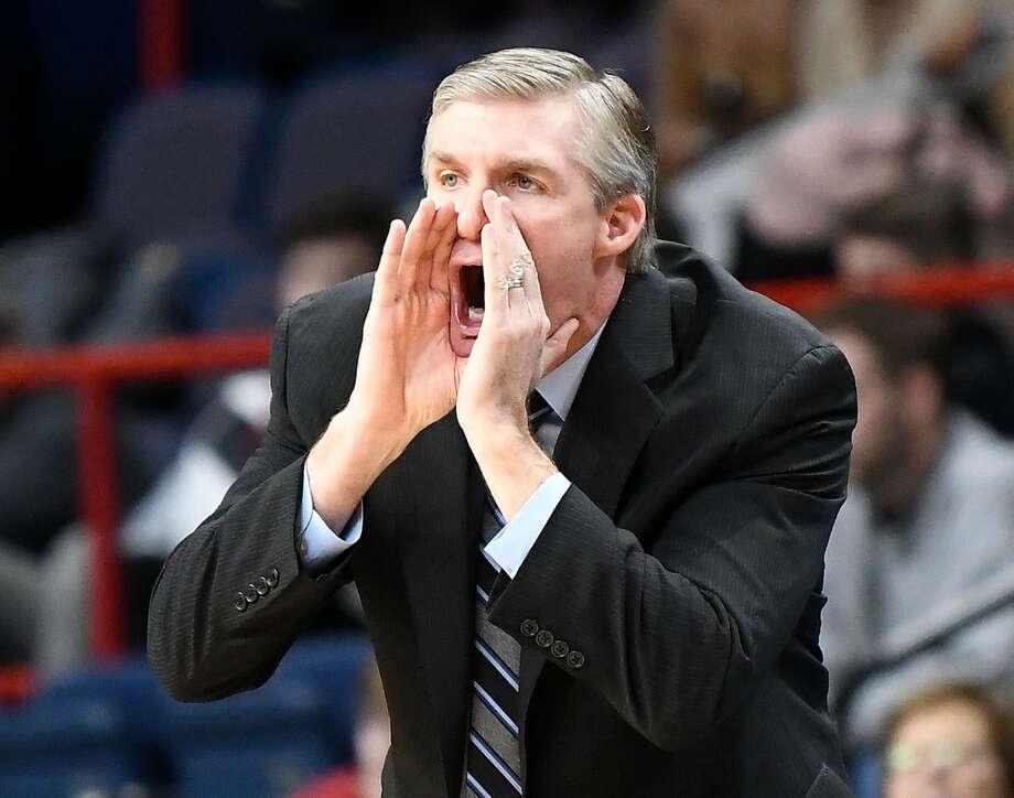 Marist head coach John Dunne won a MAAC title at Saint Peter's in 2011. Photo: Hans Pennink/Associated Press