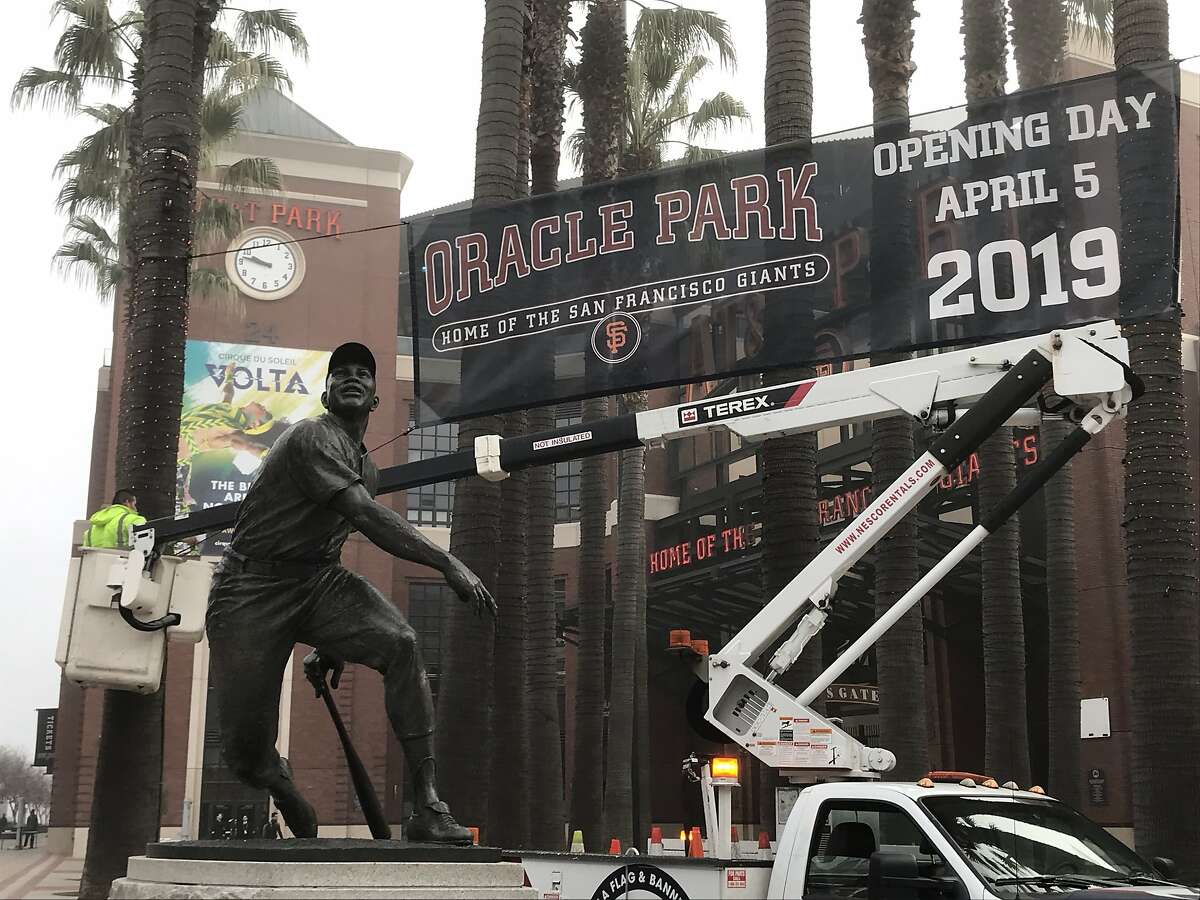 A new banner is installed with the new name of the Giants ballpark, Oracle Park, in San Francisco, Calif. on Thursday, Jan. 11, 2018.