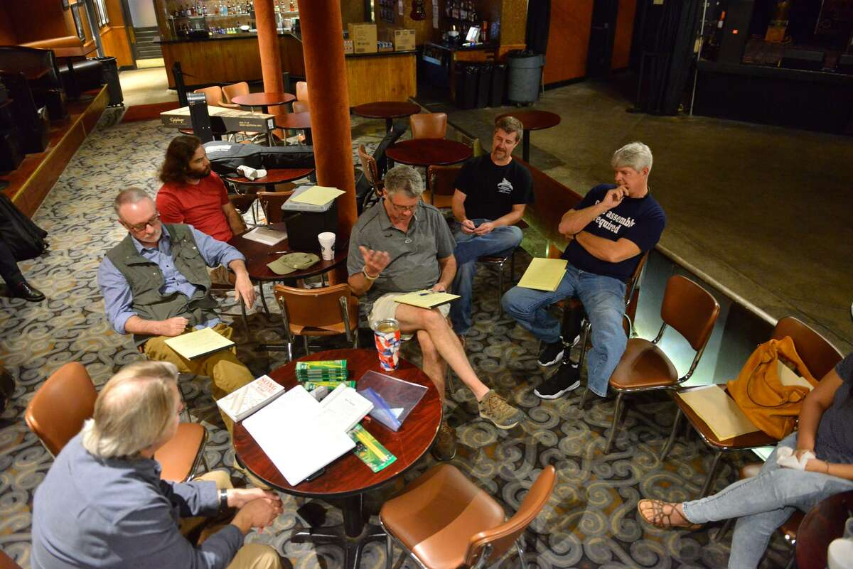 Dan Stevens (center) discuss what he wrote during the free writing exercise.