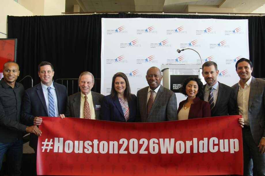 John Arnold, second from right, was named chairman of Houston's bid committee to land a host spot for the 2026 World Cup on Thursday, Jan. 10, 2019, in Houston. Joining Arnold, from left, are former Houston Dynamo player Ricardo Clark, bid committee president Chris Canetti, Harris County Houston Sports Authority chairman J. Kent Friedman, HCHSA CEO Janis Burke, Houston Mayor Sylvester Turner, Harris County Judge Lina Hidalgo and former Dynamo player Brian Ching. Photo: Courtesy Of Jules Rice/Harris County Houston Sports Authority