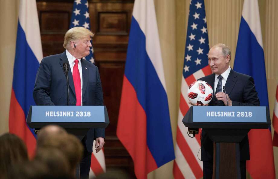 President Donald Trump smiles while Vladimir Putin, Russia's president, holds a soccer ball during a news conference in Helsinki, Finland, on July 16, 2018. Photo: Bloomberg Photo By Chris Ratcliffe. / © 2018 Bloomberg Finance LP
