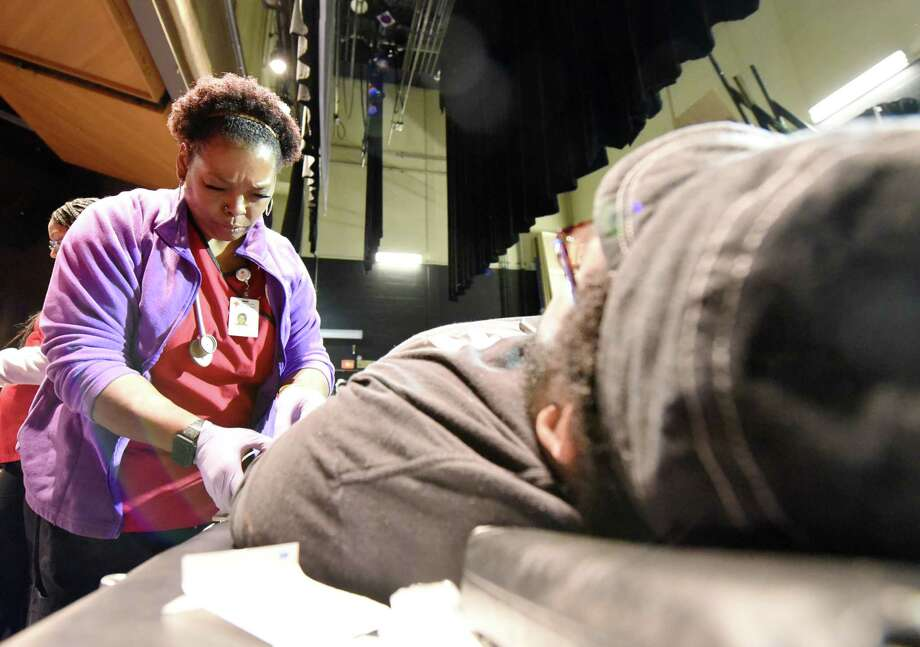 Jeena Cherry finds a vein on Dajuan Moten, 18, during the Albany High blood drive on Thursday, Jan. 10, 2019 at Albany High School in Albany, N.Y. (Phoebe Sheehan/Times Union) Photo: Phoebe Sheehan, Albany Times Union / 40045891A