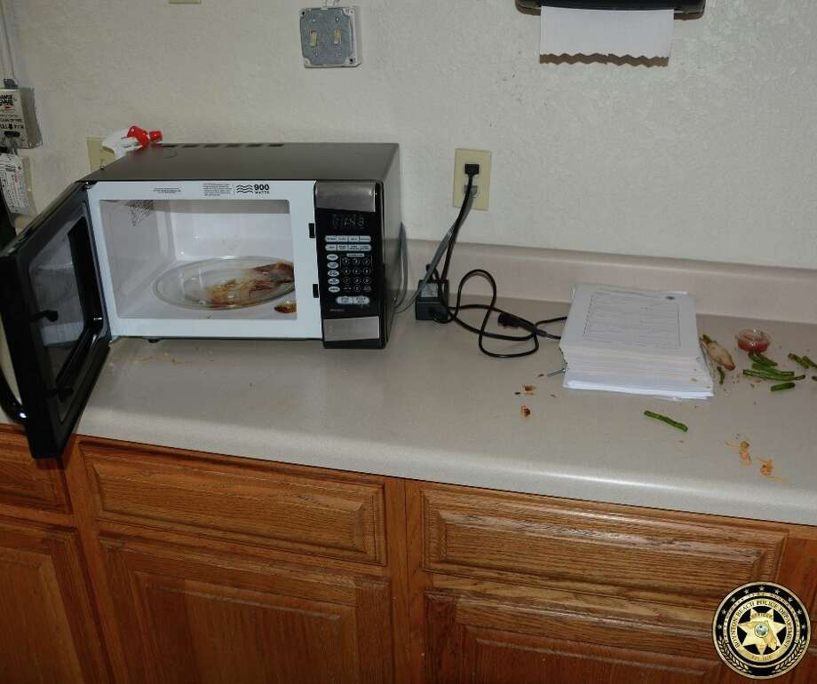 Police in Boynton Beach, Fla., say this mess was left behind by a woman who broke into the closed police station and ate a detective's chicken and asparagus dinner. The woman also left her wallet and ID behind. Photo: Boynton Beach Police Department