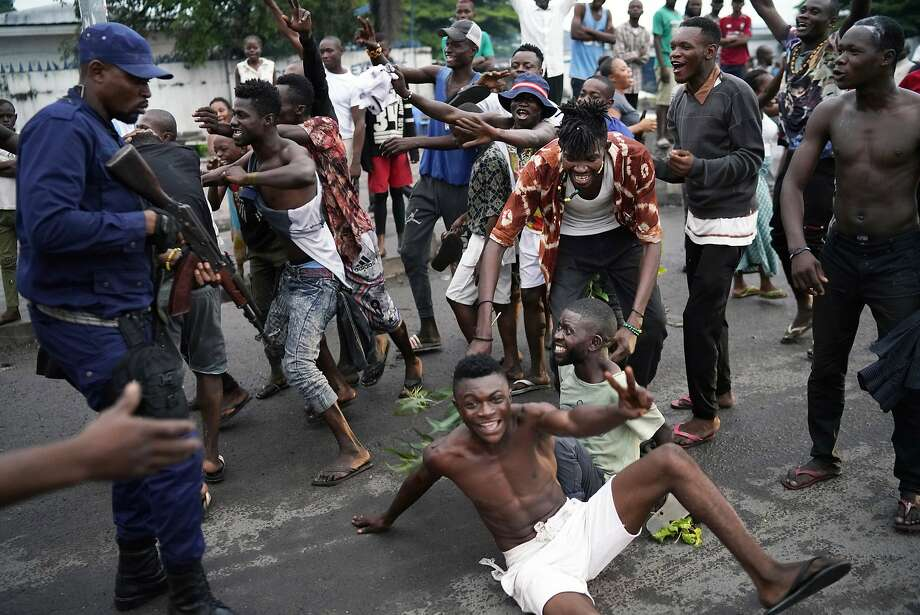 Residents celebrate in Kinshasa after learning that opposition presidential candidate Felix Tshisekedi had won the election. Photo: Jerome Delay / Associated Press
