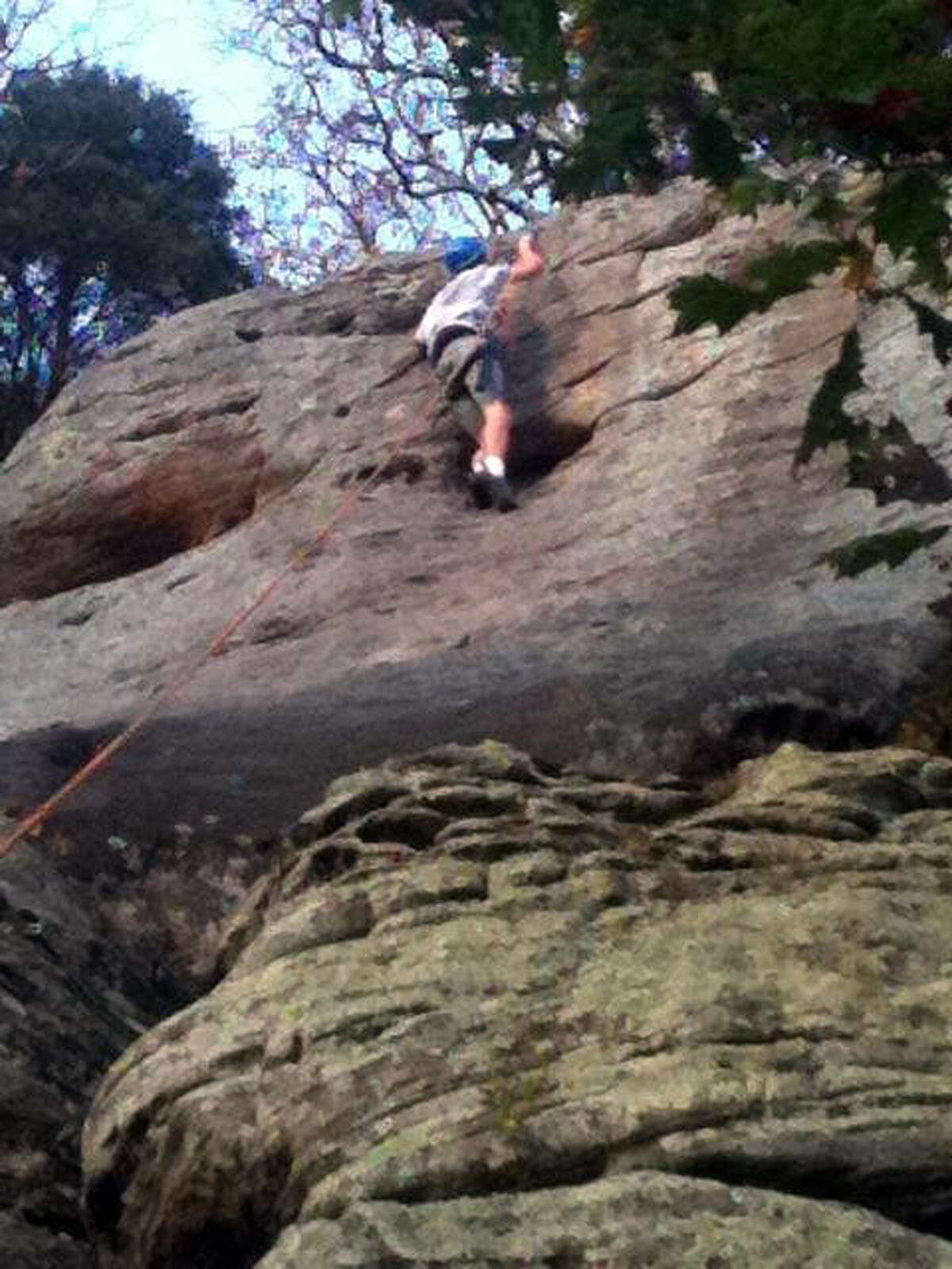 A boy scout of Edwardsville Troop 31 participates in rock climbing at a recent trip to Vertical Heartland Climbing School in Buncombe, Illinois.