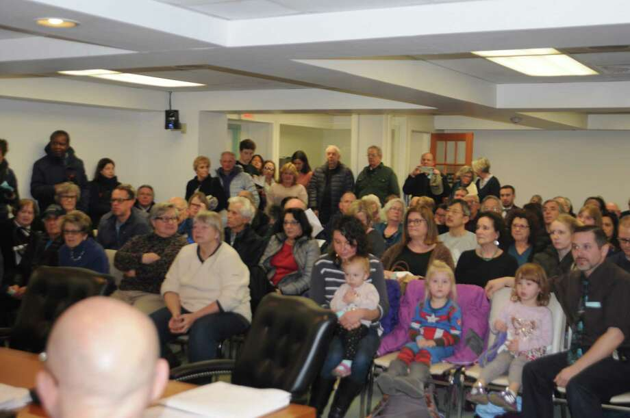 Wednesday night's selectmen's meeting in Ridgefield was standing room only as a big crowd turned out to vote on a fracking waste ban. Photo: Macklin Reid, Hearst Connecticut Media / The News-Times