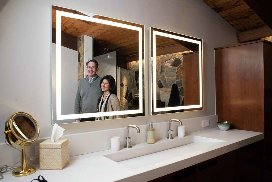 Jim and Jennifer Sergent renovated their bathroom, incorporating natural elements into the design. The Sergents are shown at home in Arlington, Virginia, on Dec. 28, 2018. Photo: Washington Post Photo By Marvin Joseph / The Washington Post