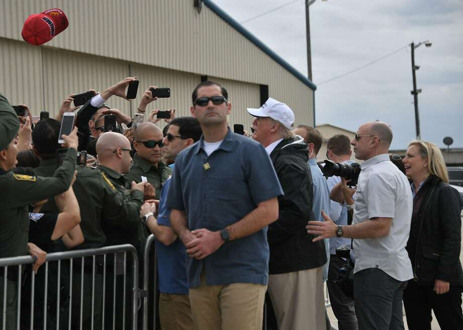 US President Donald Trump (C) visits US Border Patrol McAllen Station in McAllen, Texas, on January 10, 2019, with Homeland Security Secretary Kirstjen Nielsen (R). - Trump travels to the US-Mexico border as part of his all-out offensive to build a wall, a day after he stormed out of negotiations when Democratic opponents refused to agree to fund the project in exchange for an end to a painful government shutdown. (Photo by Jim WATSON / AFP)JIM WATSON/AFP/Getty Images Photo: JIM WATSON, AFP/Getty Images