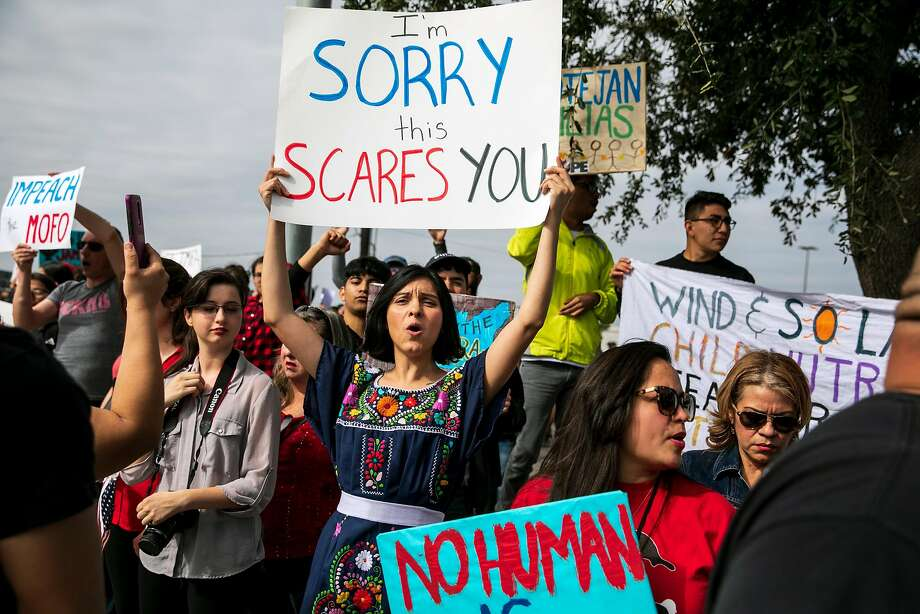 Gabrielle Hernandez, 30, and other protestors opposed to President Donald Trump's plan to build a wall along the border with Mexico await his arrival in McAllen, Texas, on Thursday, Jan. 10, 2019. Trump left Washington on Thursday on a trip to McAllen that he did not want to take to discuss a crisis on the border that Democrats say does not exist. (Ilana Panich-Linsman/The New York Times) Photo: ILANA PANICH-LINSMAN, NYT