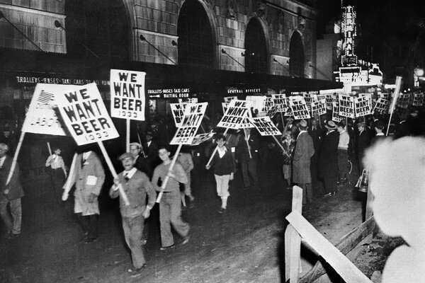 "On November 10, 1932, American workers marched in New York with signs bearing the inscription ""We Want Beer,"" demanding the end of Prohibition."