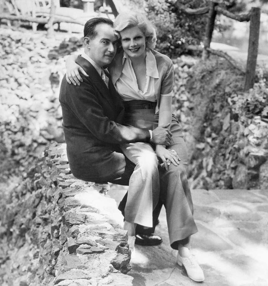 Paul Bern, noted producer, writer and studio executive, whose suicide shocked the country, and his bride, Jean Harlow. This picture was taken shortly after their 1932 marriage. Photo: Bettmann/Bettmann Archive