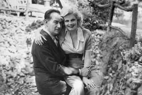 Paul Bern, noted producer, writer and studio executive, whose suicide shocked the country, and his bride, Jean Harlow. This picture was taken shortly after their 1932 marriage.