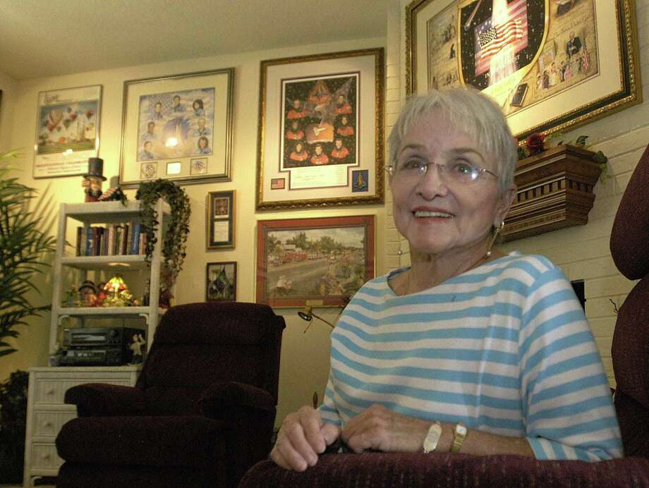 "Longtime Friendswood artist Laurie Whitehead, shown in 2004 at home among some of her watercolors is being remembered for her work and for the influence she had in the city as a friend and mentor. Whitehead, who died in December, said that her talent was a ""God-given thing."" Photo: Kim Christensen, Freelance / Special To The Chronicle / freelance"