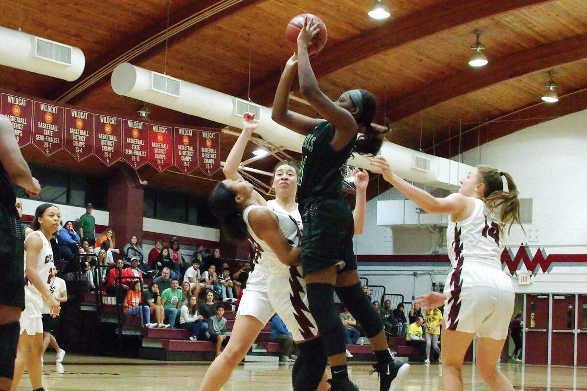 Lauren Sinclair (23) of Clear Creek tries to draw a foul from Clear Falls' Josephine Adegbite as she puts up a shot in a District 24-6A basketball game Tuesday night.