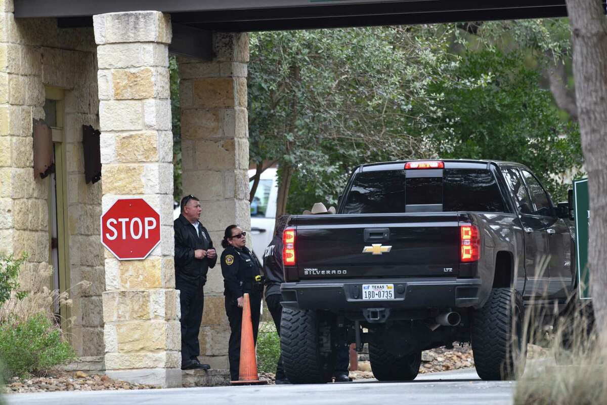 Security and Bexar County Sheriff's personnel check traffic going into the Anaqua Springs Ranch gated community where three people were found dead today, Jan. 10, 2019.