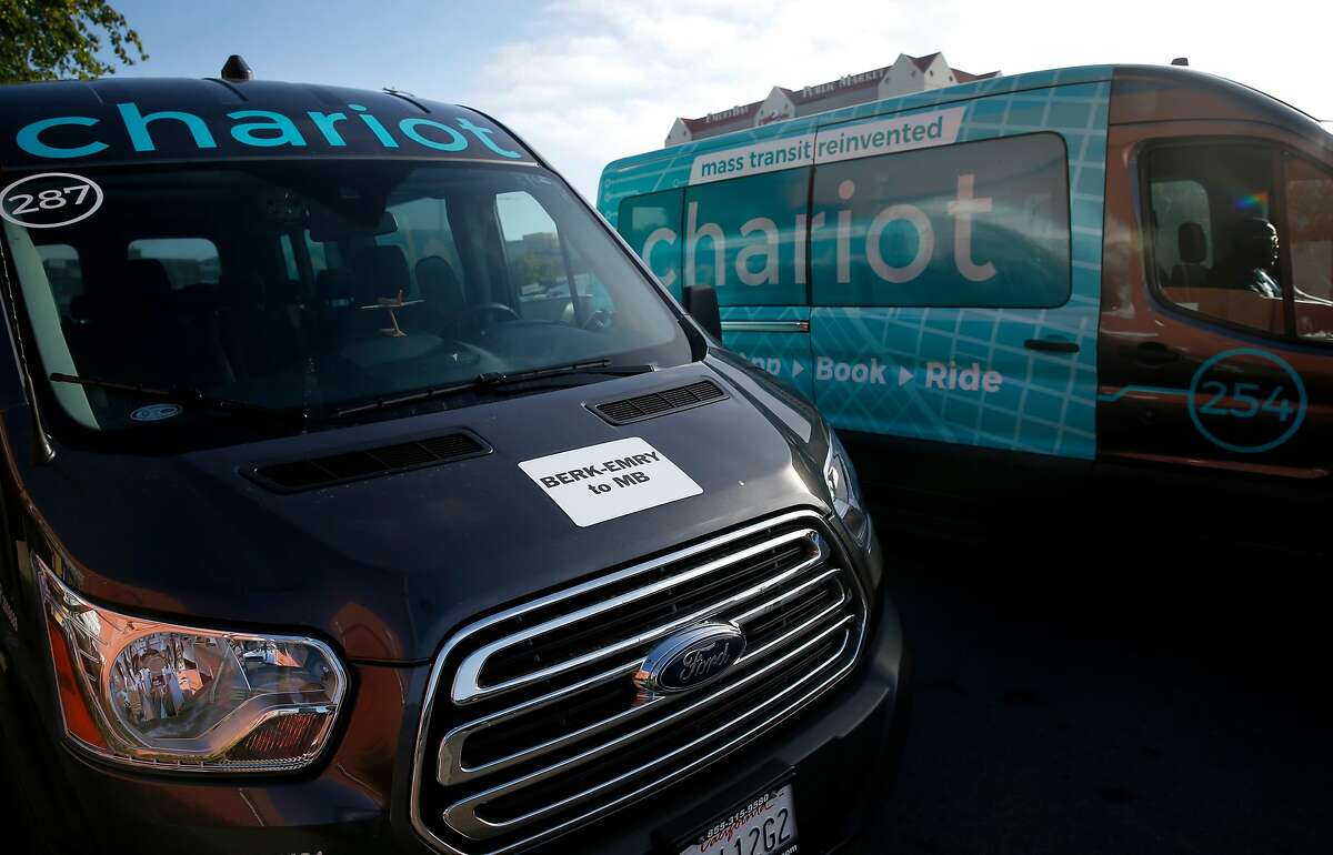 Chariot shuttle vans are seen near a commuter stop on Christie Avenue in Emeryville, Calif. on Tuesday, June 26, 2018. A grant from the Metropolitan Transportation Commission is subsidizing commuter runs for UCSF employees to provide transportation between East Bay locations and the Mission Bay campus.