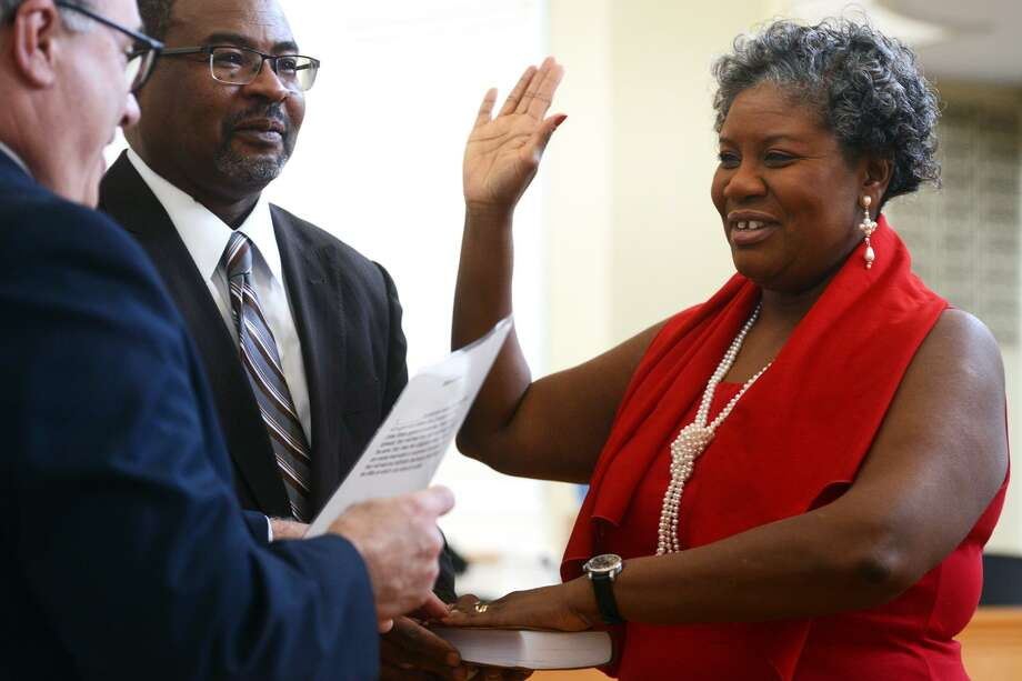 Jeanette Sherrod is sworn in as Postmaster for the City of Milford during a ceremony at City Hall, in Milford, Conn. Jan. 10, 2019. Sherrod is the city's first African-American Female Postmaster. Photo: Ned Gerard / Hearst Connecticut Media / Connecticut Post