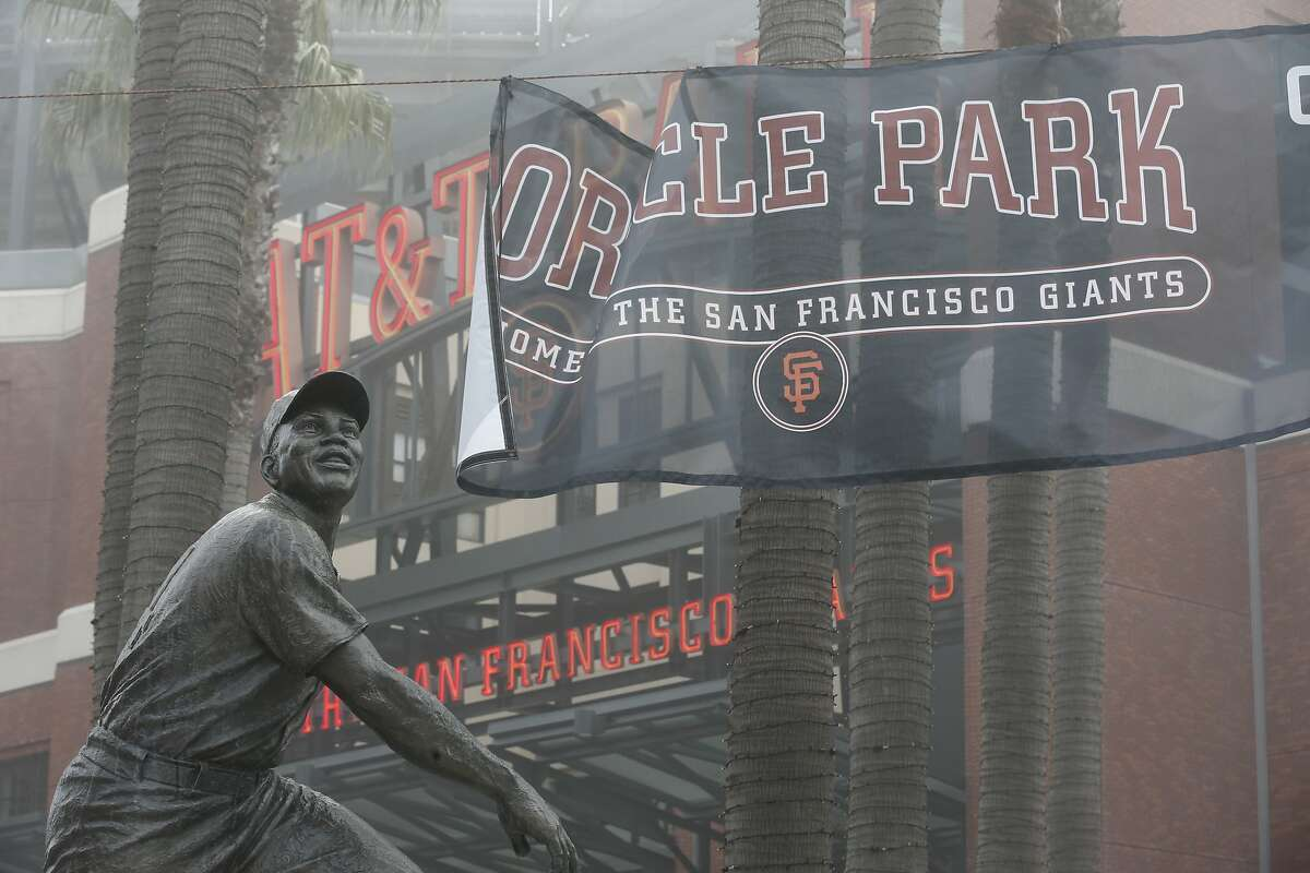 A new banner is installed with the new name of the Giants ballpark, Oracle Park, in San Francisco, Calif. on Thursday, Jan. 10, 2018.