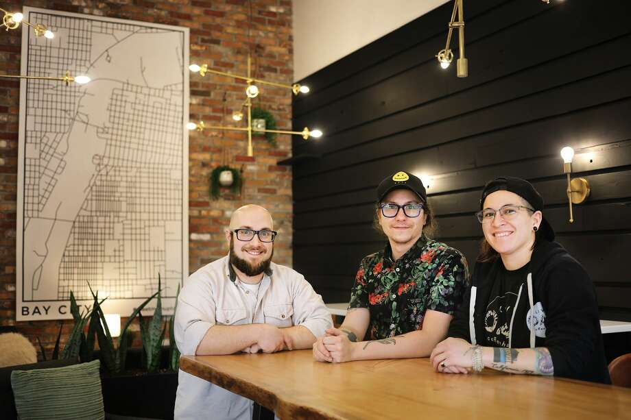 From left, Live Oak Coffeehouse managers Daniel Terhune, Sean Bartley and Jazzmyn Benitez pose for a portrait inside their new location at 5 E. Main St. in Bay City on Thursday, Jan. 10, 2019. The new location officially opens Saturday, Jan. 12. (Katy Kildee/kkildee@mdn.net) Photo: (Katy Kildee/kkildee@mdn.net)