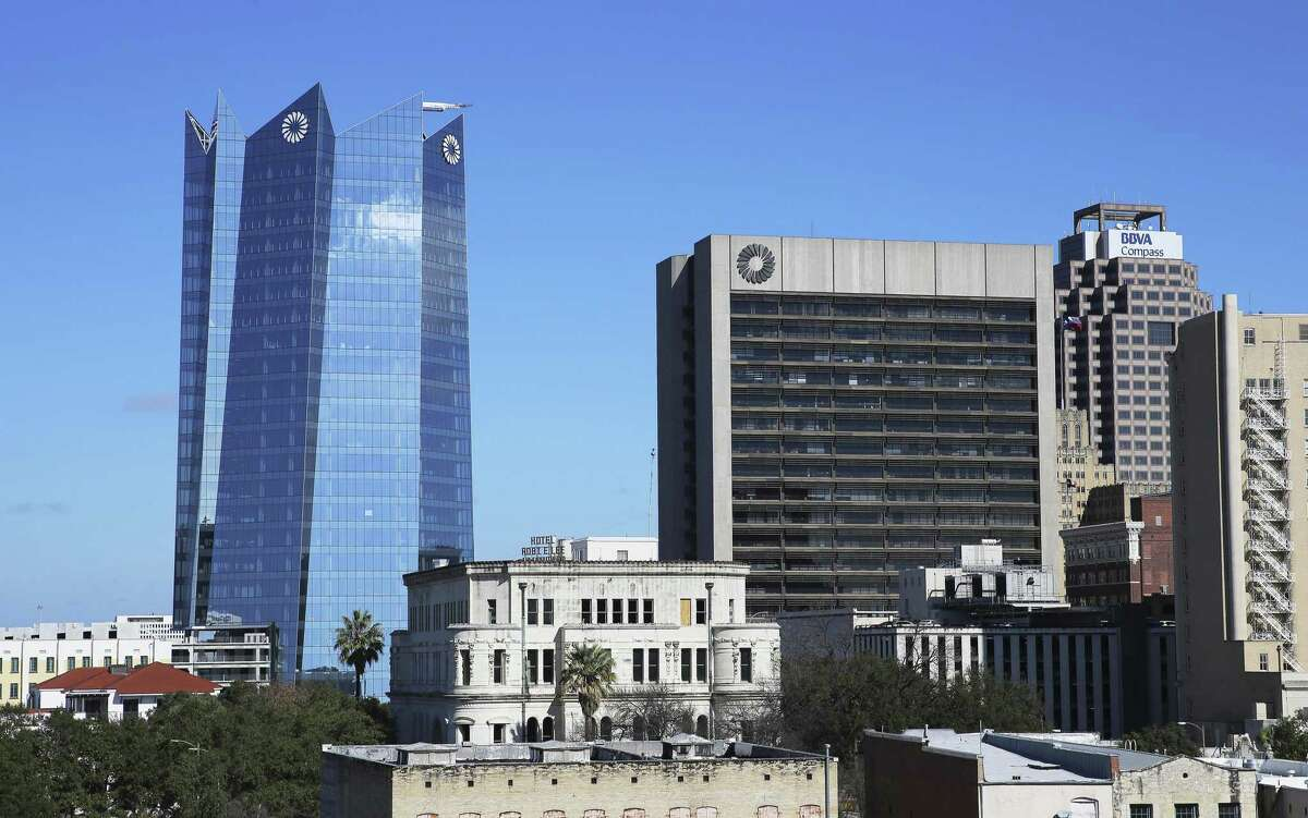 Juxtaposition of the older Frost Bank building and the new Frost Bank building in downtown San Antonio on Thursday, Jan. 3, 2019. (Kin Man Hui/San Antonio Express-News)