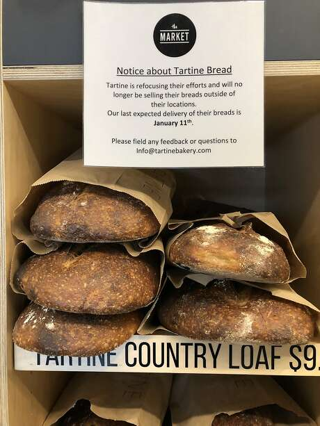 A sign at The Market on Market informing shoppers that Tartine bread will no longer be carried. Photo: The Chronicle