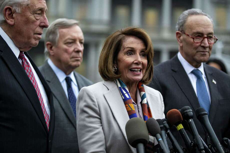 House Minority Leader Nancy Pelosi, D-Calif., speaks while Senate Minority Leader Chuck Schumer, D-N.Y., right, listens during a news conference on Jan. 2, 2018. Photo: Bloomberg Photo By Al Drago / Bloomberg