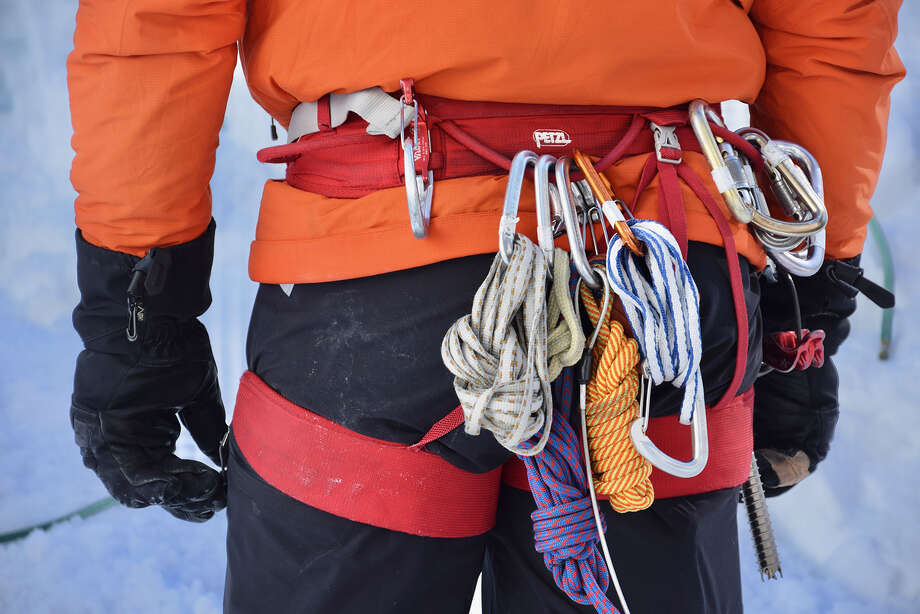 Larry Shiu, a teacher with Yamnuska Mountain Adventures, keeps extra ropes and carabiners on his harness. (Mark Johanson/Chicago Tribune/TNS) Photo: Mark Johanson / Chicago Tribune
