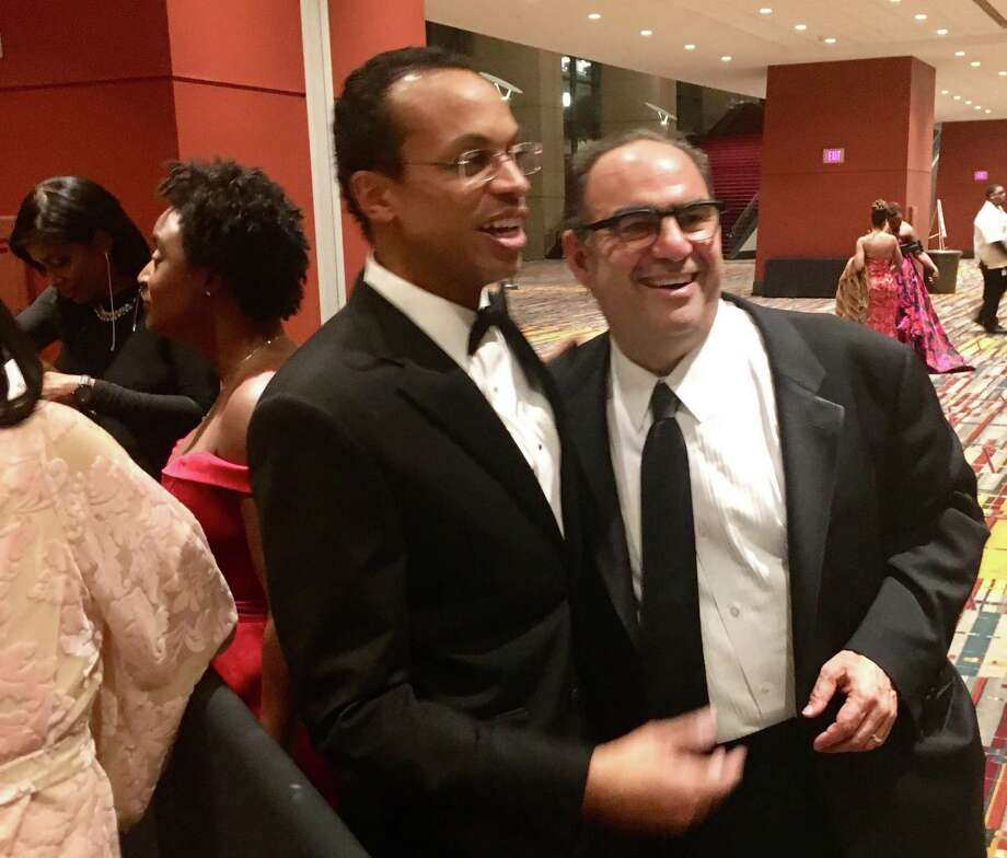 Connecticut state Treasurer Shawn Wooden, center, with Alan Lazowski, chairman and CEO of LAZ Parking, one of the nation's largest parking companies, at the inaugural ball in Hartford on Wednesday night, Jan. 9, 2019. Lazowski founded LAZ in 1981 when he was a student at UConn. He and Wooden and neighbors and friends. Photo: Dan Haar /Hearst Conencticut Media