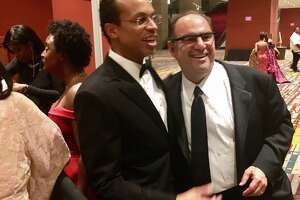 Connecticut state Treasurer Shawn Wooden, center, with Alan Lazowski, chairman and CEO of LAZ Parking, one of the nation's largest parking companies, at the inaugural ball in Hartford on Wednesday night, Jan. 9, 2019. Lazowski founded LAZ in 1981 when he was a student at UConn. He and Wooden and neighbors and friends.