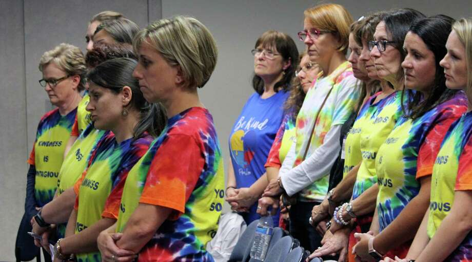 Early Childhood Center teachers and staff stand in solidarity while a letter is read to the Board of Education imploring the board to keep the ECC in one location on Sept. 11. Photo: Genevieve Reilly / Hearst Connecticut Media / Fairfield Citizen