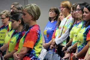 Early Childhood Center teachers and staff stand in solidarity while a letter is read to the Board of Education imploring the board to keep the ECC in one location on Sept. 11.