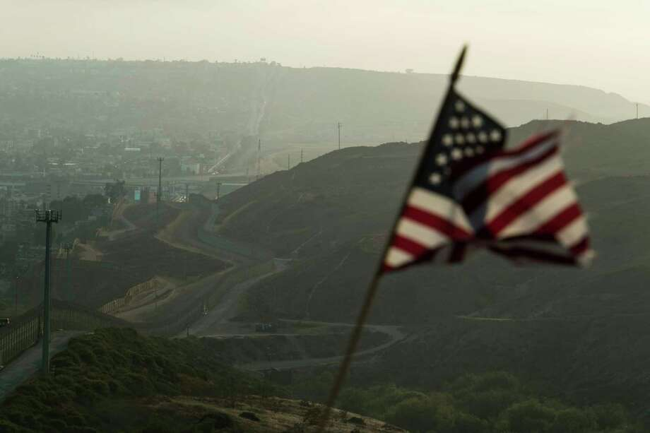 The San Diego sector of the border wall, with Tijuana, Mexico, on the left, shown at sunset in April 2018. Photo: Washington Post Photo By Carolyn Van Houten. / The Washington Post