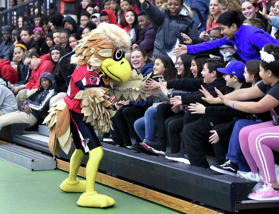 Freddie Falcon, the Atlanta Falcons mascot, mingles with students from Carrigan Intermediate School of West Haven during the Walter Camp Staying in School Rally at the Floyd Little Athletic Center in New Haven on January 10, 2019. Photo: Arnold Gold / Hearst Connecticut Media / New Haven Register