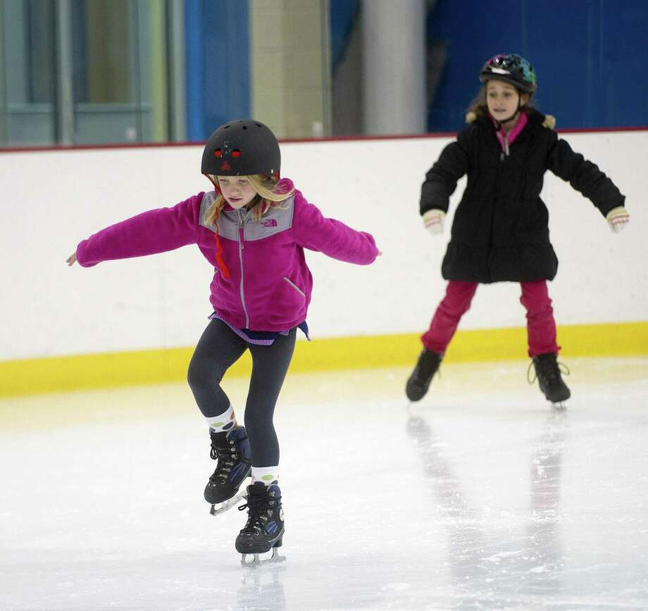 Gracie Barker takes a figure skating lesson at Chelsea Piers Connecticut in Stamford on December 18, 2013. Photo: Lindsay Perry / File Photo / Stamford Advocate
