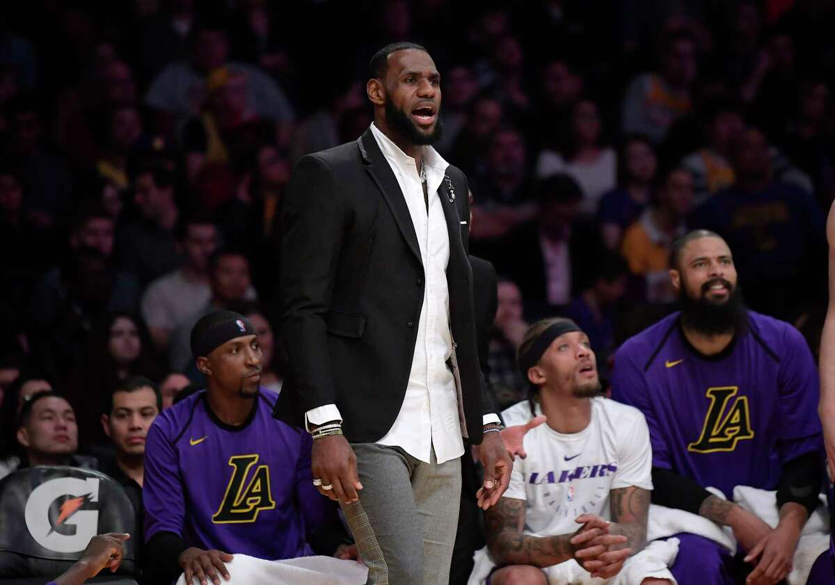 Los Angeles Lakers forward LeBron James stands near the bench during the second half of an NBA basketball game against the New York Knicks Friday, Jan. 4, 2019, in Los Angeles. The Knicks won 119-112. (AP Photo/Mark J. Terrill)