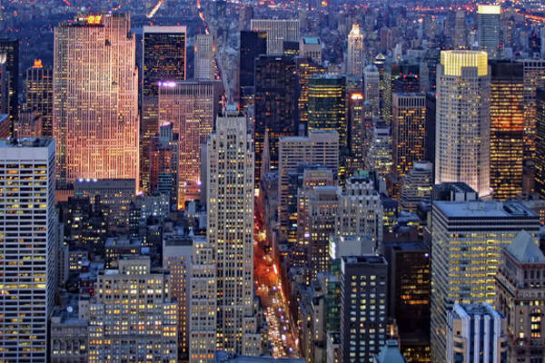 The number of New York hotels with extra nightly fees has doubled in the past year.