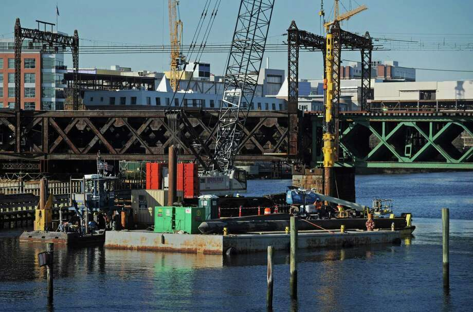 Middlesex Construction workers drive pilings from a barge in the Norwalk River on Nov. 8 in preparation for the Walk Bridge replacement project in Norwalk. Photo: Erik Trautmann / Hearst Connecticut Media / Norwalk Hour