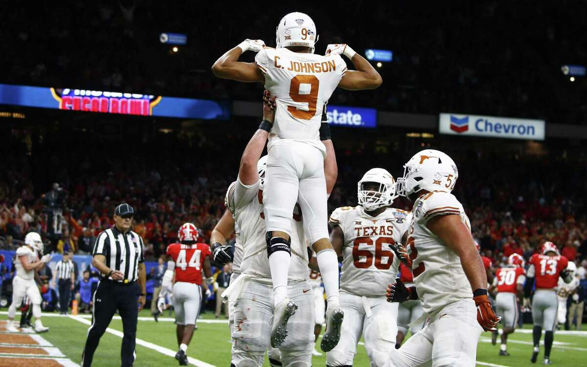Texas wide receiver Collin Johnson (9) celebrates his 2-point conversion in the second half of the Sugar Bowl NCAA college football game against Georgia in New Orleans, Tuesday, Jan. 1, 2019. (AP Photo/Butch Dill)